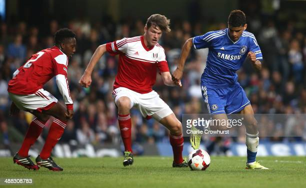 Dominic Solanke of Chelsea breaks away from Fulham's Cameron Burgess and Ryheem Sheckleford during the FA Youth Cup Final Second Leg match between...