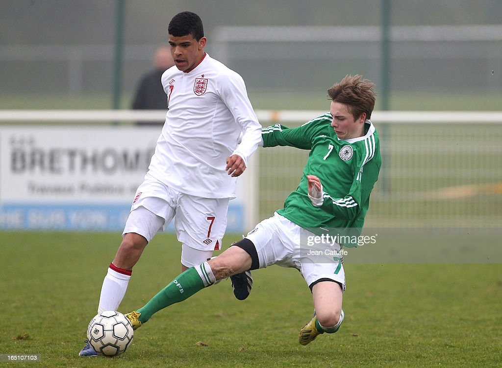 Dominic Solanke of England and Finn Porath of Germany in action during the Tournament of Montaigu qualifier match between U16 Germany and U16 England at the Stade Saint Andre D'Ornay on March 30, 2013 in La Roche-sur-Yon, France.