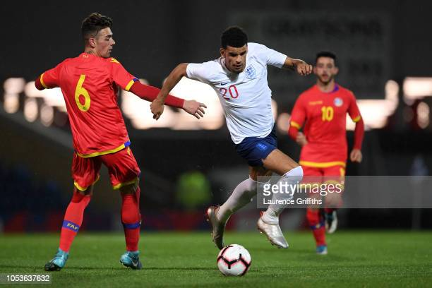 Dominic Solanke of England goes past Christian Garcia of Andorra during the 2019 UEFA European Under21 Championship Qualifier between England U21 and...