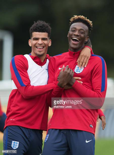 Dominic Solanke of England shares a joke with team mate Tammy Abraham during an England Under 21 training session at St George's Park on August 30...