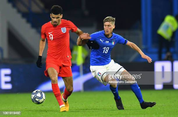 Dominic Solanke of England u21 competes for the ball with Filippo Romagna of Italy U21 during the International friendly match between Italy U21 and...