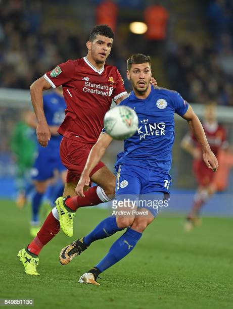 Dominic Solanke of Liverpool and Aleksandar Dragovic of Leicester compete for the ball during the Carabao Cup third round match between Leicester...