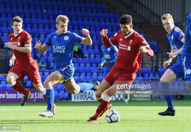 Dominic Solanke of Liverpool and Kiernan DewsburyHall of Leicester City in action during the Liverpool v Leicester City PL2 game at Prenton Park on...