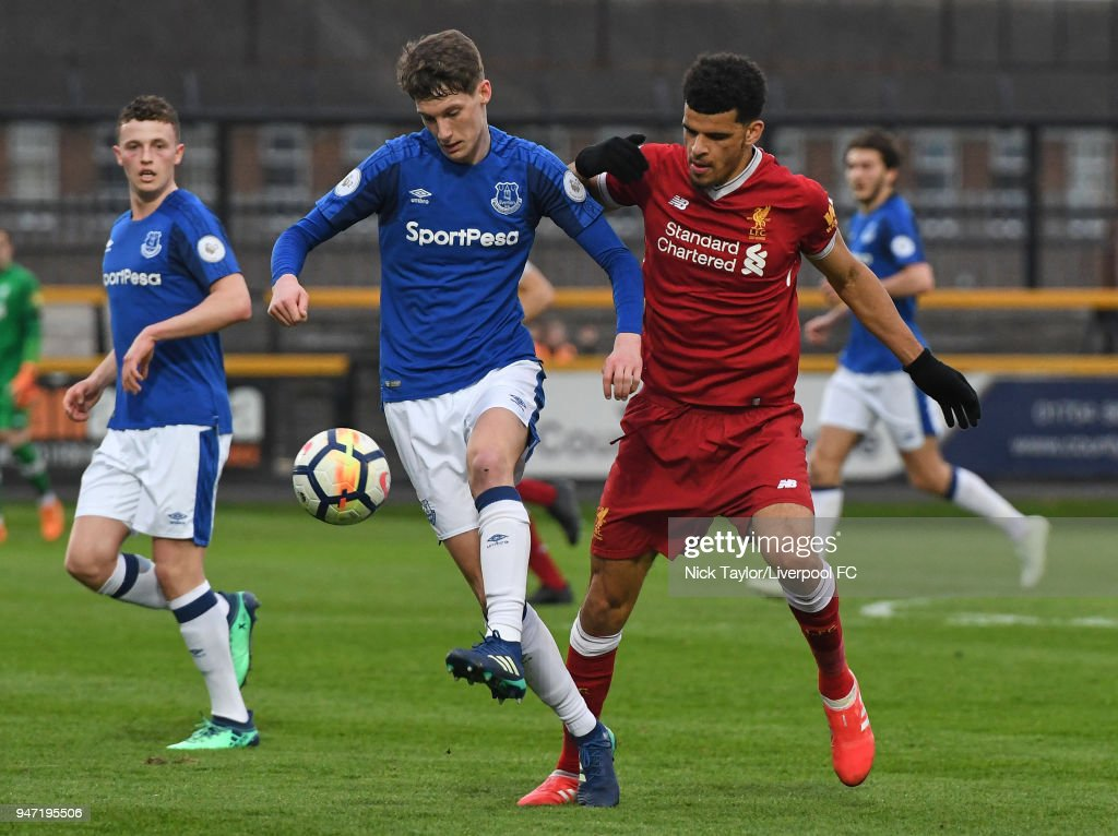 Dominic Solanke of Liverpool and Matthew Foulds of Everton in action during the Everton v Liverpool PL2 game on April 16, 2018 in Southport, England.