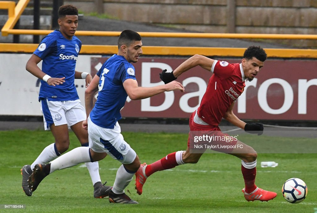 Dominic Solanke of Liverpool and Nathangelo Markello and Con Ouzounidis of Everton in action during the Everton v Liverpool PL2 game on April 16, 2018 in Southport, England.