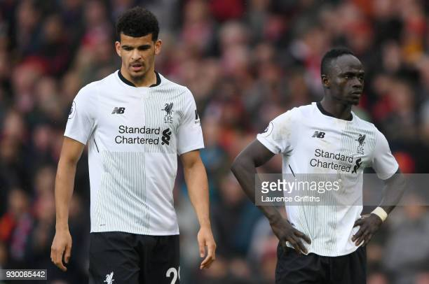 Dominic Solanke of Liverpool and Sadio Mane of Liverpool look dejected after the Premier League match between Manchester United and Liverpool at Old...