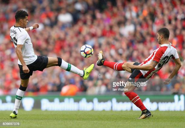 Dominic Solanke of Liverpool and Unai Nunez of Athletic Club battle for possession during the Pre Season Friendly match between Liverpool and...