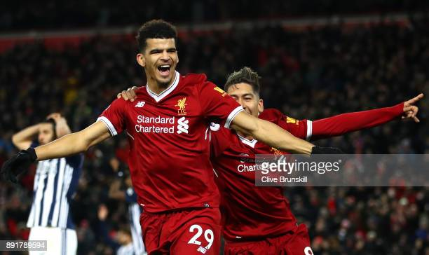Dominic Solanke of Liverpool celebrates after scoring his sides first goal with Roberto Firmino of Liverpool but it is later disallowed during the...