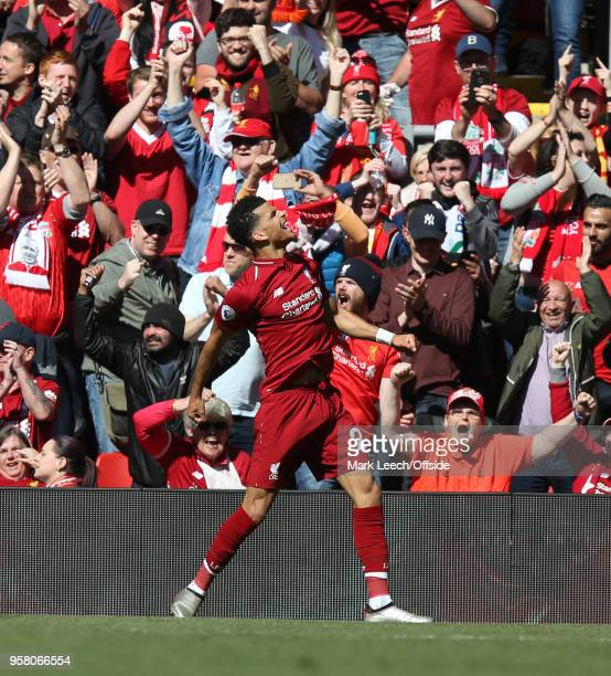 Dominic Solanke of Liverpool celebrates after scoring the third goal for his team during the Premier League match between Liverpool and Brighton and...