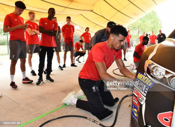 Dominic Solanke of Liverpool changing tyres during a tour of Roush Fenway Racing on July 21 2018 in Charlotte North Carolina