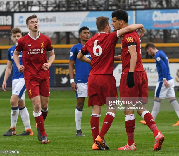 Dominic Solanke of Liverpool is congratulated by team mate Herbie Kane after scoring from the penalty spot during the Everton v Liverpool PL2 game on...