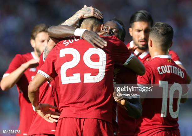 Dominic Solanke of Liverpool jubilates with team mates after scoring the first goal during the pre season friendly match between Hertha BSC and FC...