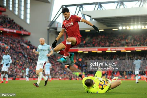 Dominic Solanke of Liverpool jumps over the advancing West Ham goalkeeper Adrian during the Premier League match between Liverpool and West Ham...