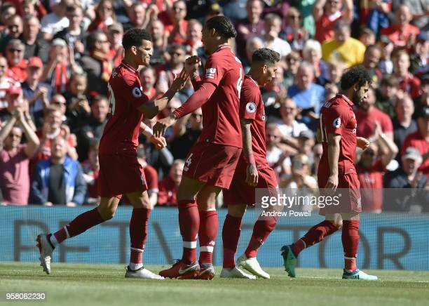 Dominic Solanke of Liverpool scores and celebrates the third goal during the Premier League match between Liverpool and Brighton and Hove Albion at...