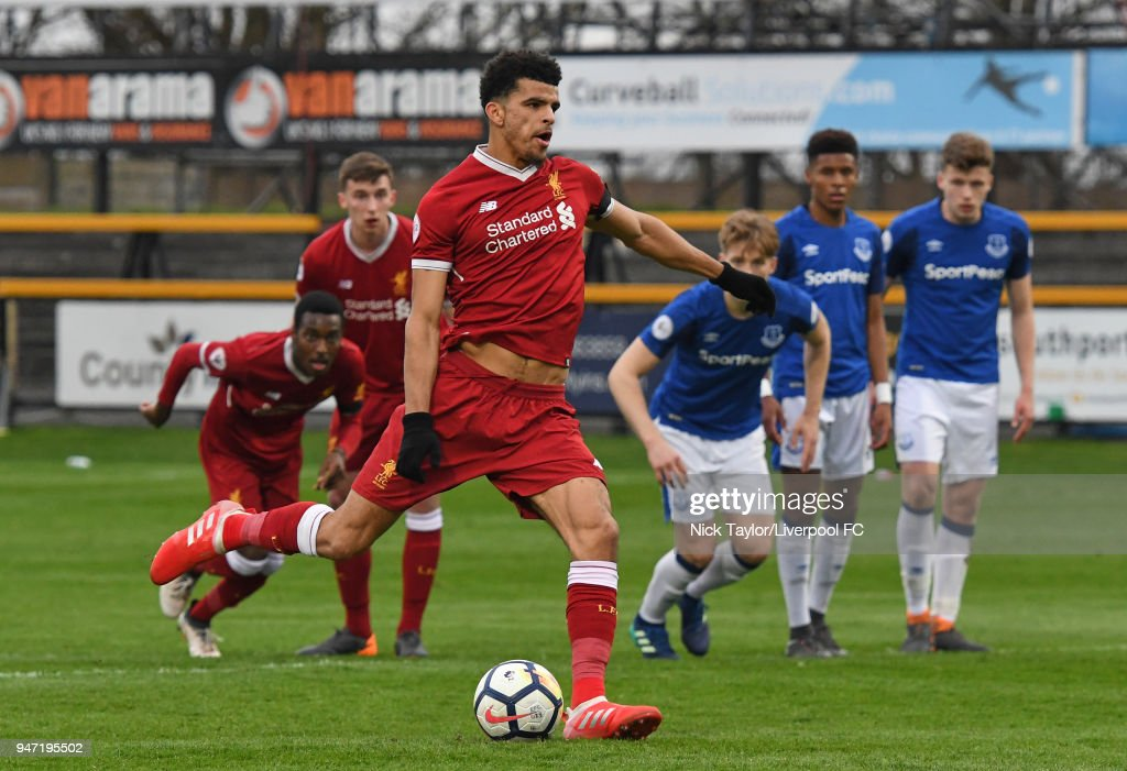 Dominic Solanke of Liverpool scores from the penalty spot during the Everton v Liverpool PL2 game on April 16, 2018 in Southport, England.