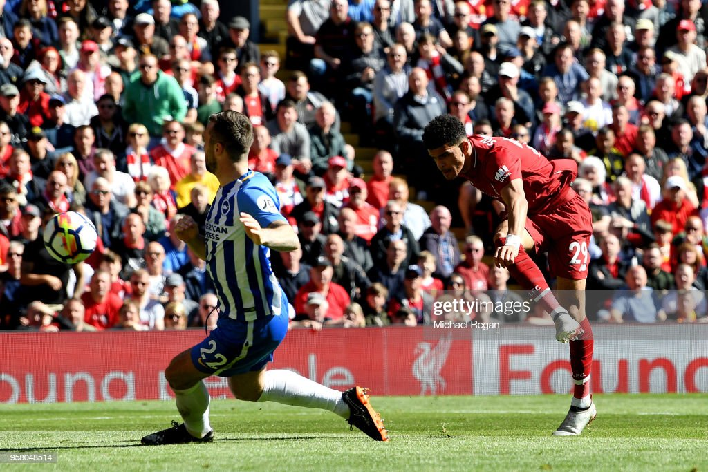 Dominic Solanke of Liverpool scores his sides third goal during the Premier League match between Liverpool and Brighton and Hove Albion at Anfield on May 13, 2018 in Liverpool, England.