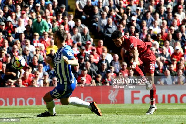 Dominic Solanke of Liverpool scores his sides third goal during the Premier League match between Liverpool and Brighton and Hove Albion at Anfield on...
