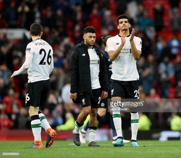 Dominic Solanke of Liverpool shows his appreciation to the fans at the end of the Premier League match between Manchester United and Liverpool at Old...