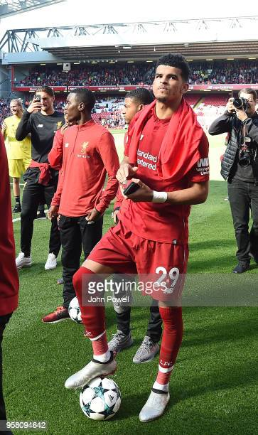 Dominic Solanke of Liverpool shows his appreciation to the fans at the end of the Premier League match between Liverpool and Brighton and Hove Albion...