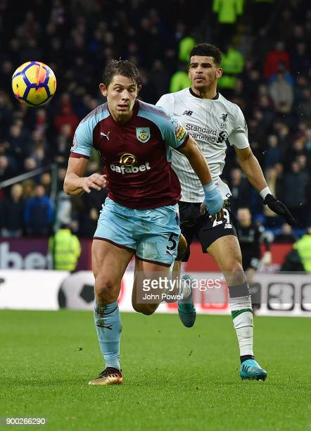 Dominic Solanke of Liverpool with James Tarkowski of Burnley during the Premier League match between Burnley and Liverpool at Turf Moor on January 1...