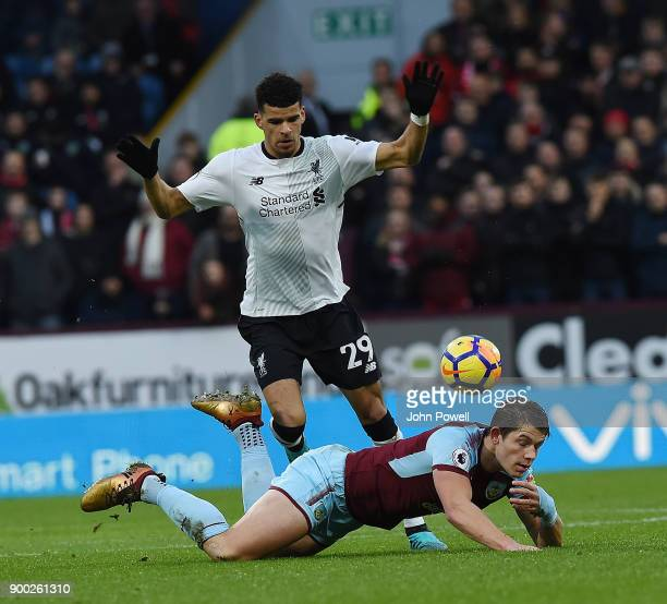 Dominic Solanke of Liverpool with Phil Bardsley of Burnley during the Premier League match between Burnley and Liverpool at Turf Moor on January 1...