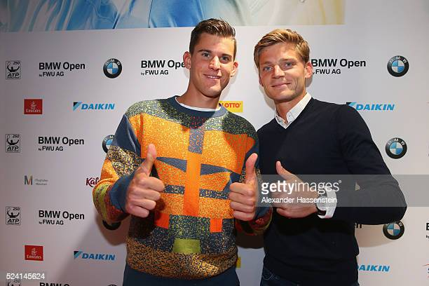 Dominic Thieam of Austria arrives with David Goffin of Belgium for the Players Night of the BMW Open at Iphitos tennis club on April 25, 2016 in...
