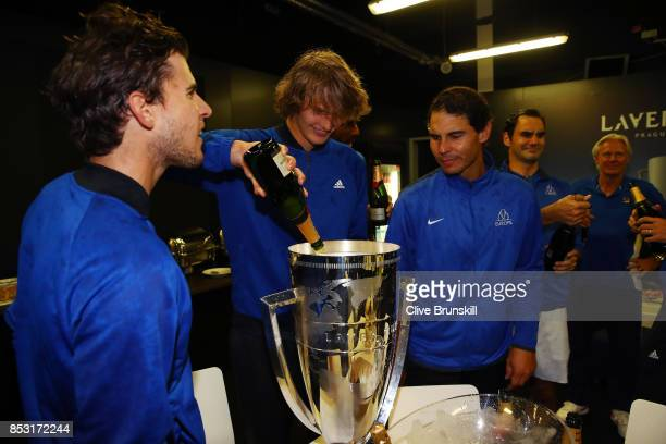 Dominic Thiem Alexander Zverev Rafael Nadal Roger Federer of Team Europe drink champagne after winning the Laver Cup on the final day of the Laver...
