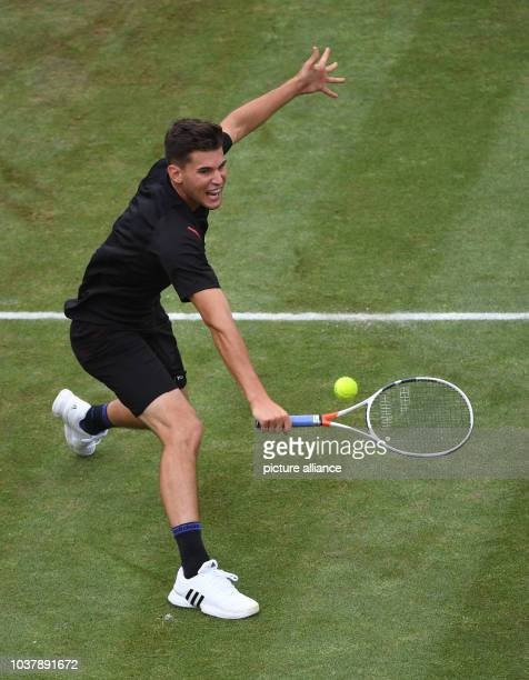 Dominic Thiem from Austria in action against Federer from Switzerland during the semifinals at the ATP Tournament at Weissenhof in Stuttgart Germany...