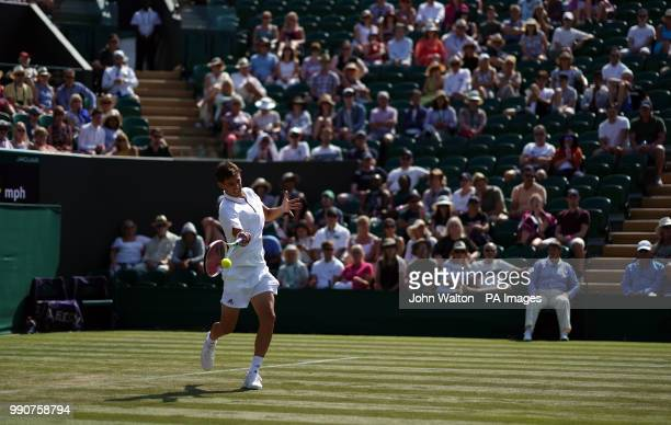 Dominic Thiem in action against Marcos Baghdatis on day two of the Wimbledon Championships at the All England Lawn Tennis and Croquet Club Wimbledon