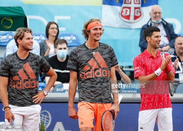Dominic Thiem of Austria, Alexander Zverev of Germany and Novak Djokovic of Serbia smile after the exhibition double match of the Adria Tour charity...