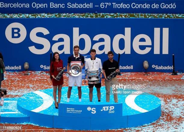 Dominic Thiem of Austria and Daniil Medvedev of Russia posse with the trophies on day seven of the Barcelona Open Banc Sabadell at Real Club De Tenis...
