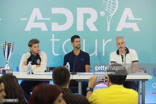 Dominic Thiem of Austria and Novak Djokovic of Serbia hold a press conference after Thiem wins the final match against Filip Krajinovic of Serbia at...
