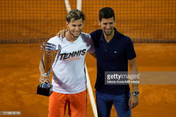 Dominic Thiem of Austria and Novak Djokovic of Serbia posing for photographers after the final match on June 14 during the 3rd day of Summer Adria...