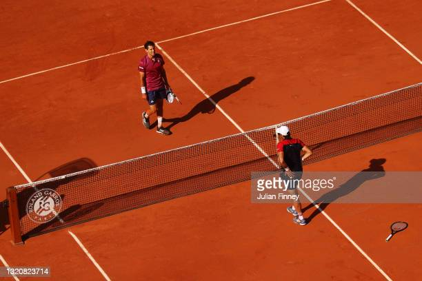 Dominic Thiem of Austria and Pablo Andujar of Spain walk to the net after their First Round match during Day One of the 2021 French Open at Roland...