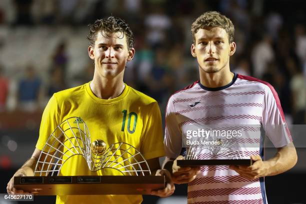 Dominic Thiem of Austria and Pablo Carreno Busta of Spain pose for photographers after their ATP World Tour 500 Rio Open tennis final match at Jockey...