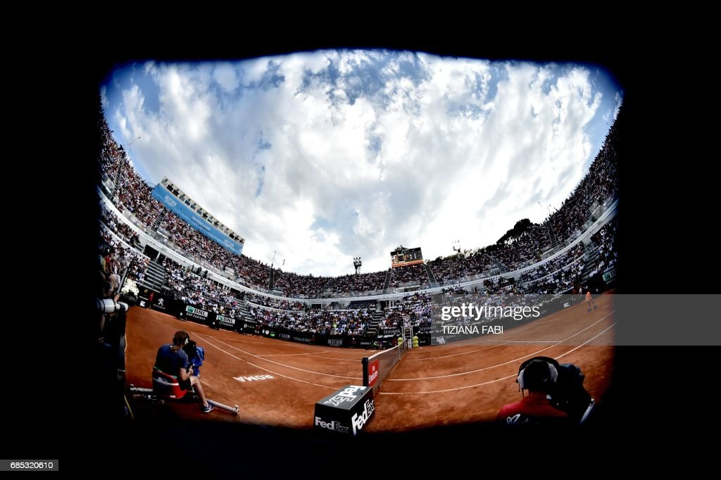Dominic Thiem of Austria and Rafael Nadal of Spain play during their quarter-final at the ATP Tennis Open tournament on May 19, 2017 at the Foro Italico in Rome. Dominic Thiem sent Rafael Nadal crashing out of the Rome Masters with a 6-4, 6-3 quarter-final victory, ending the Spaniard's 17-match winning run. /