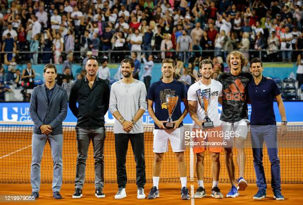 Dominic Thiem of Austria and runnerup Filip Krajinovic of Serbia pose with their trophies after the final match along with Dusan Lajovic of Serbia...