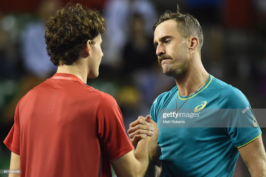 Dominic Thiem of Austria and Steve Johnson of the USA ahke hands after their match during day two of the Rakuten Open at Ariake Coliseum on October 3, 2017 in Tokyo, Japan.