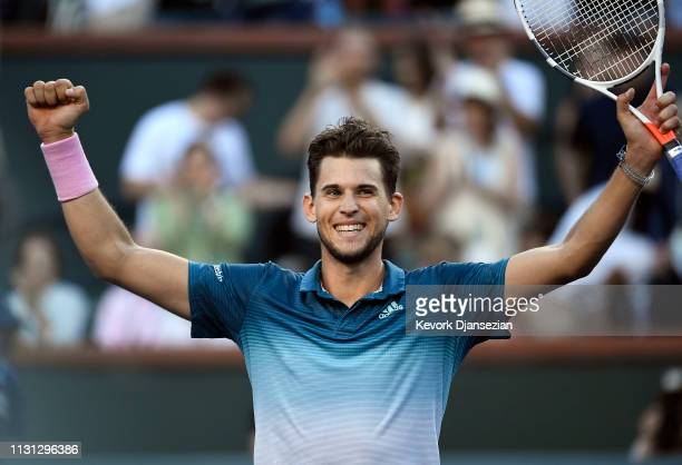 Dominic Thiem of Austria celebrates after defeating Roger Federer of Switzerland in the men's singles final on day fourteen of the BNP Paribas Open...