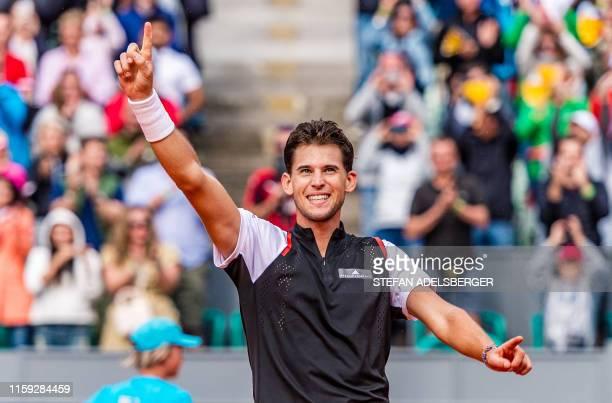 Dominic Thiem of Austria celebrates after winning against Albert RamosVinolas of Spain in the singles final match of the Generali Open Tennis...