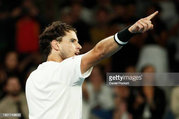 Dominic Thiem of Austria celebrates after winning his Men's Singles third round match against Nick Kyrgios of Australia during day five of the 2021...