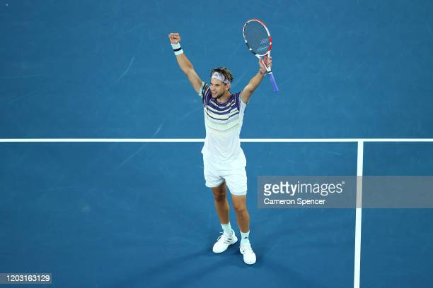 Dominic Thiem of Austria celebrates after winning match point during his Men's Singles Semifinal match against Alexander Zverev of Germany on day...