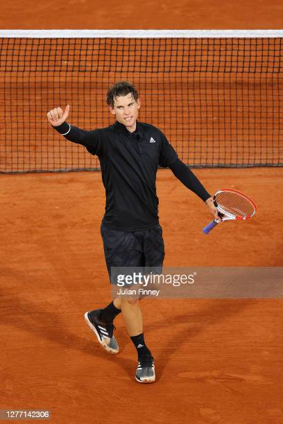Dominic Thiem of Austria celebrates after winning match point during his Men's Singles first round match against Marin Cilic of Croatia on day two of...