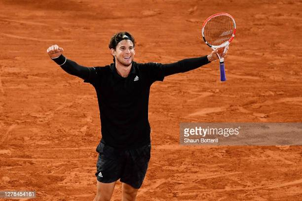 Dominic Thiem of Austria celebrates after winning match point during his Men's Singles fourth round match against Hugo Gaston of France on day eight...