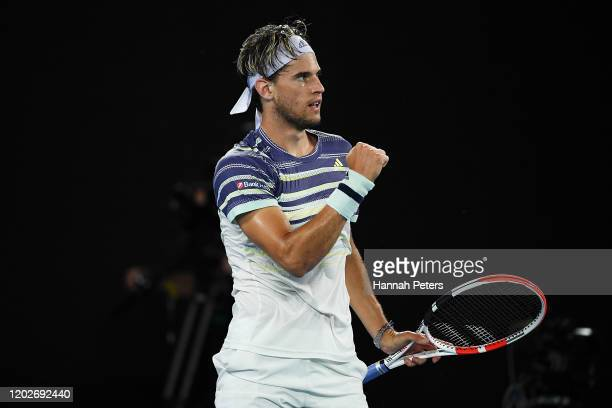 Dominic Thiem of Austria celebrates after winning the first set during his Men's Singles Quarterfinal match against Rafael Nadal of Spain on day ten...