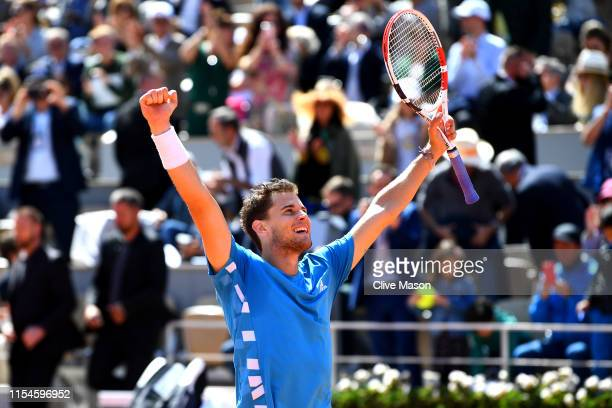Dominic Thiem of Austria celebrates at match point during his mens singles semifinal match against Novak Djokovic of Serbia during Day fourteen of...