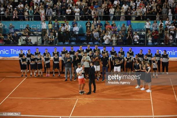 Dominic Thiem of Austria celebrates by raising the trophy after winning the final match against Filip Krajinovic of Serbia at the Adria Tour charity...