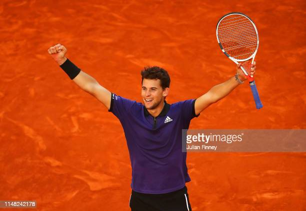 Dominic Thiem of Austria celebrates defeating Roger Federer of Switzerland during day seven of the Mutua Madrid Open at La Caja Magica on May 10 2019...