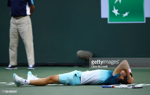 Dominic Thiem of Austria celebrates his men's singles final victory against Roger Federer of Switzerland on day fourteen of the BNP Paribas Open at...