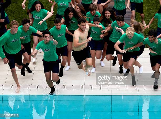 Dominic Thiem of Austria celebrates his win on the swimming pool after defeating Daniil Medvedev of Russia during the final match on day seven of the...